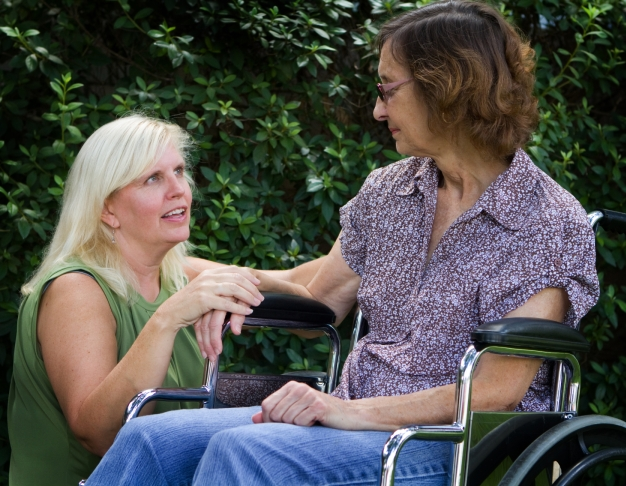 Attendant Care Woman talking to woman in wheelchair